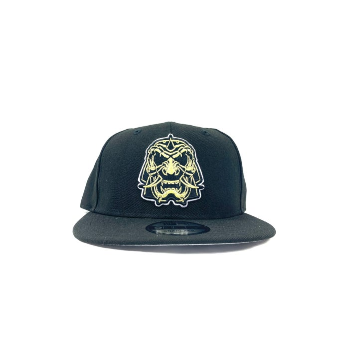"Image of 2520 X NEW ERA SENSHI AKA ""THE WARRIOR"" 9 FIFTY SNAPBACK -BLACK/VEGAS GOLD"