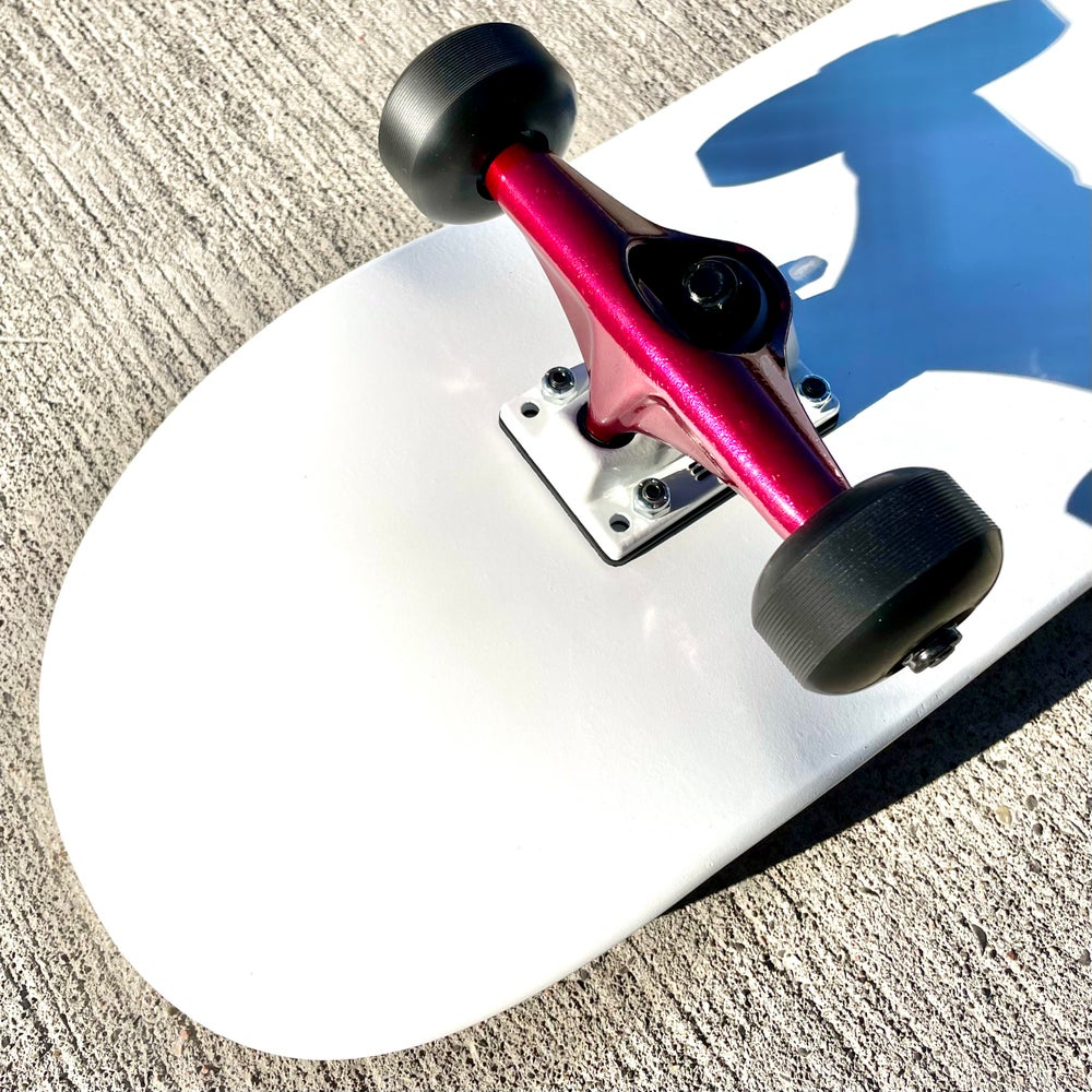 Image of White Complete Skateboard w/ Red Core Trucks
