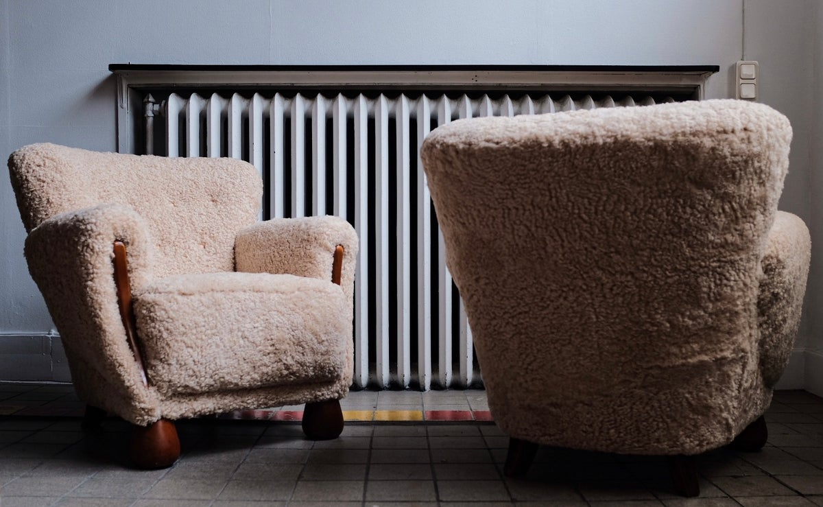 A pair of 1950s sheepskin easy chairs