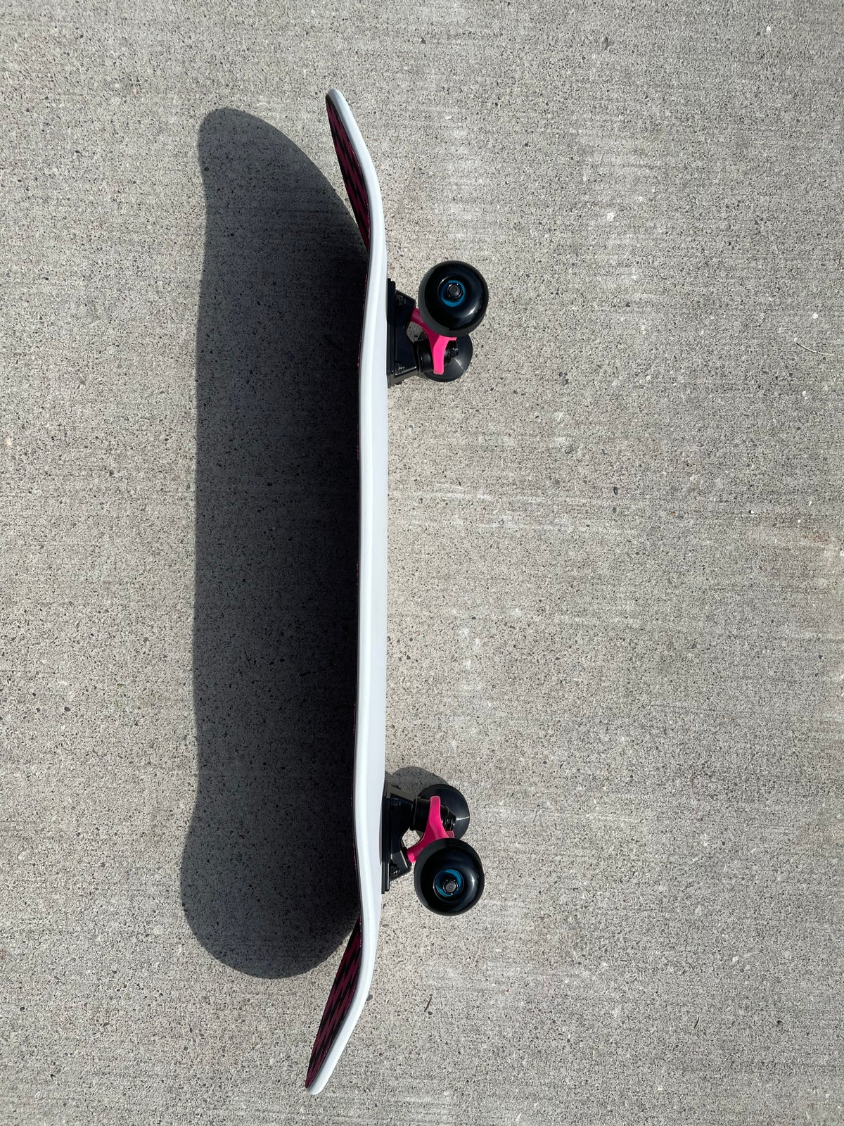 Image of White Complete Skateboard w/ Pink Trucks