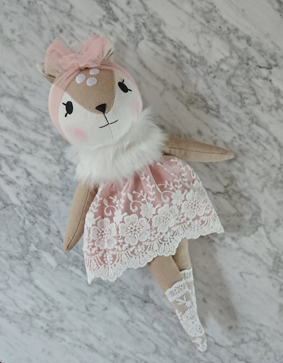 Image of Fawn in mauve dress