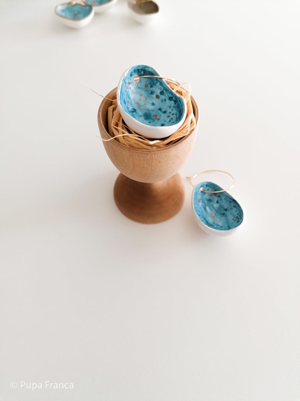 Image of Eggshell Earrings in blue with golden dots