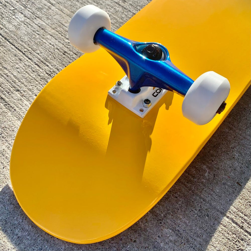 Image of Yellow Complete Skateboard w/ Metallic Blue Trucks