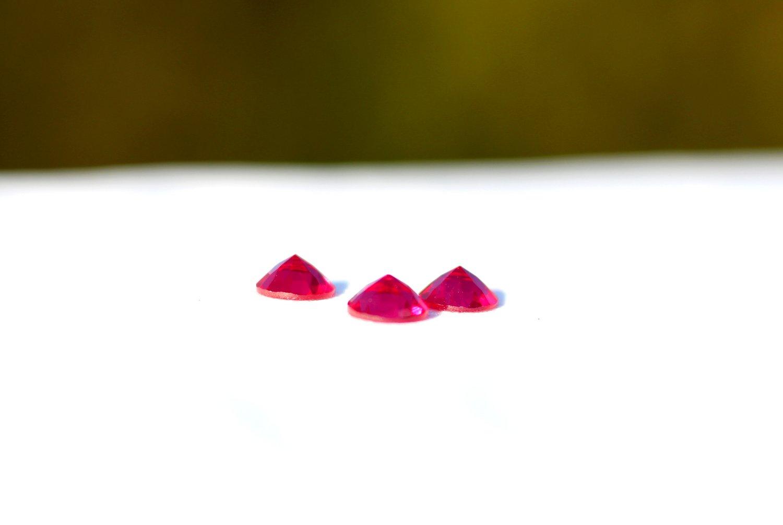 Image of 8mm Ruby Faceted Half Gem