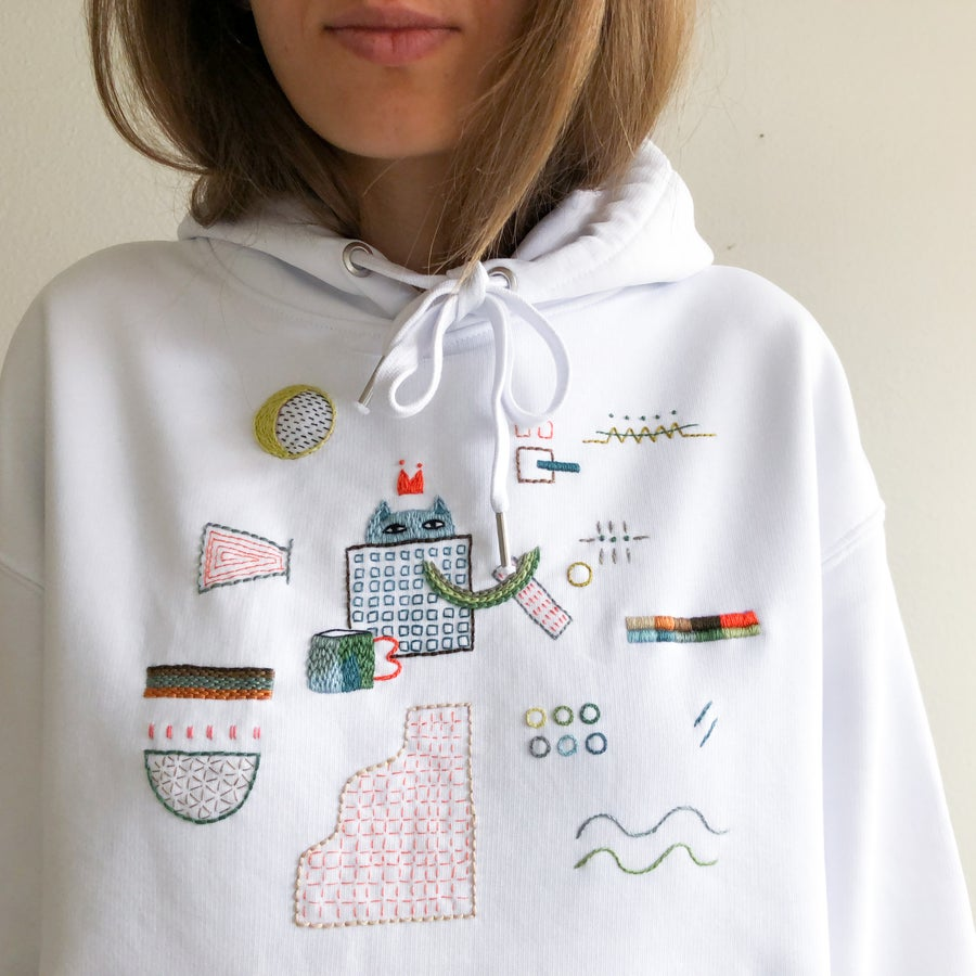 Image of Cat hiding from drama - hand embroidered organic cotton hoodie, Unisex, one of a kind