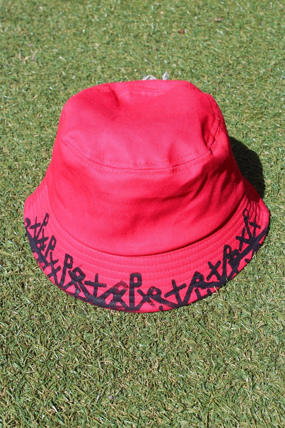 too many bucket hat in red