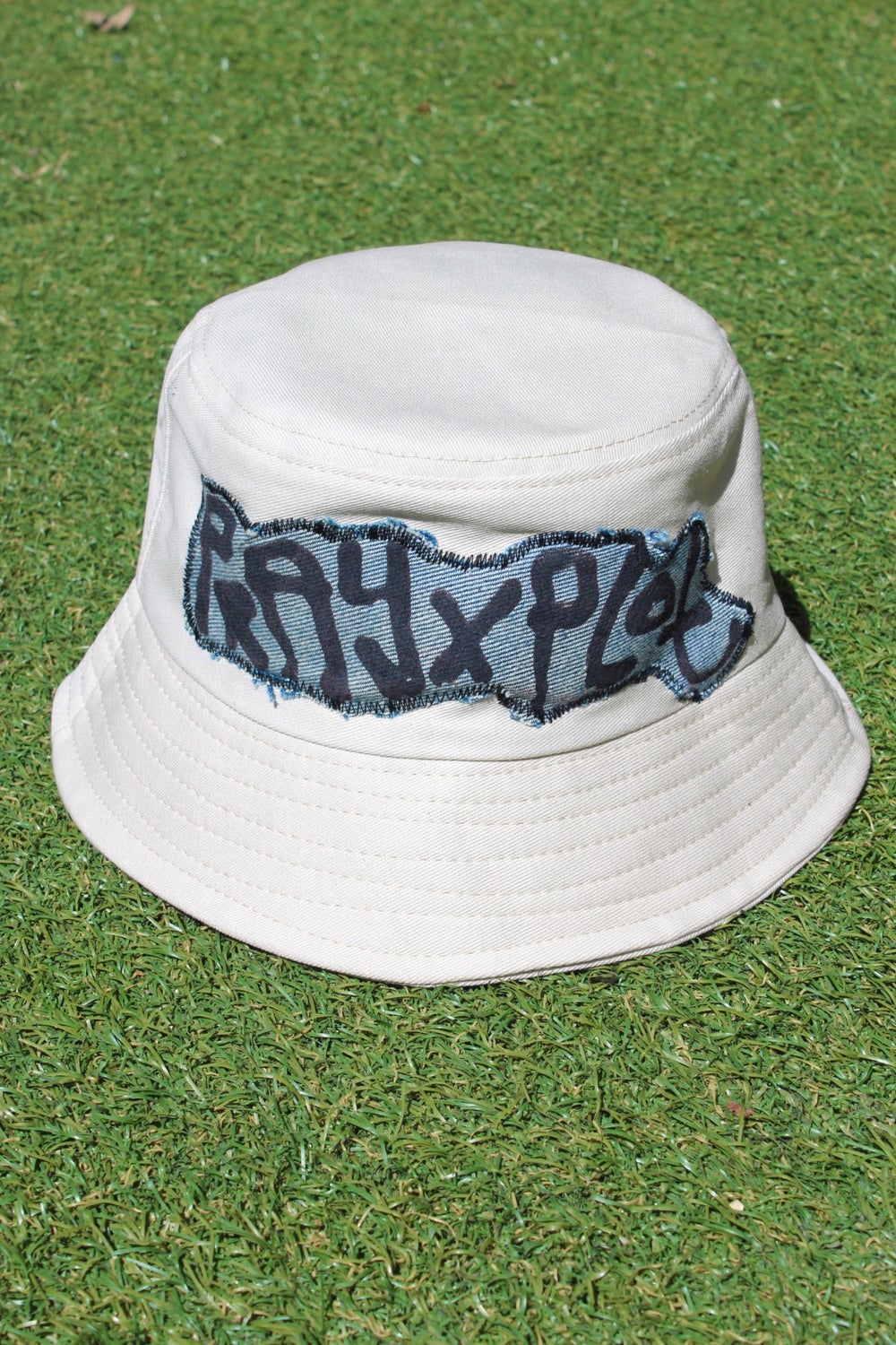up front bucket hat in tan