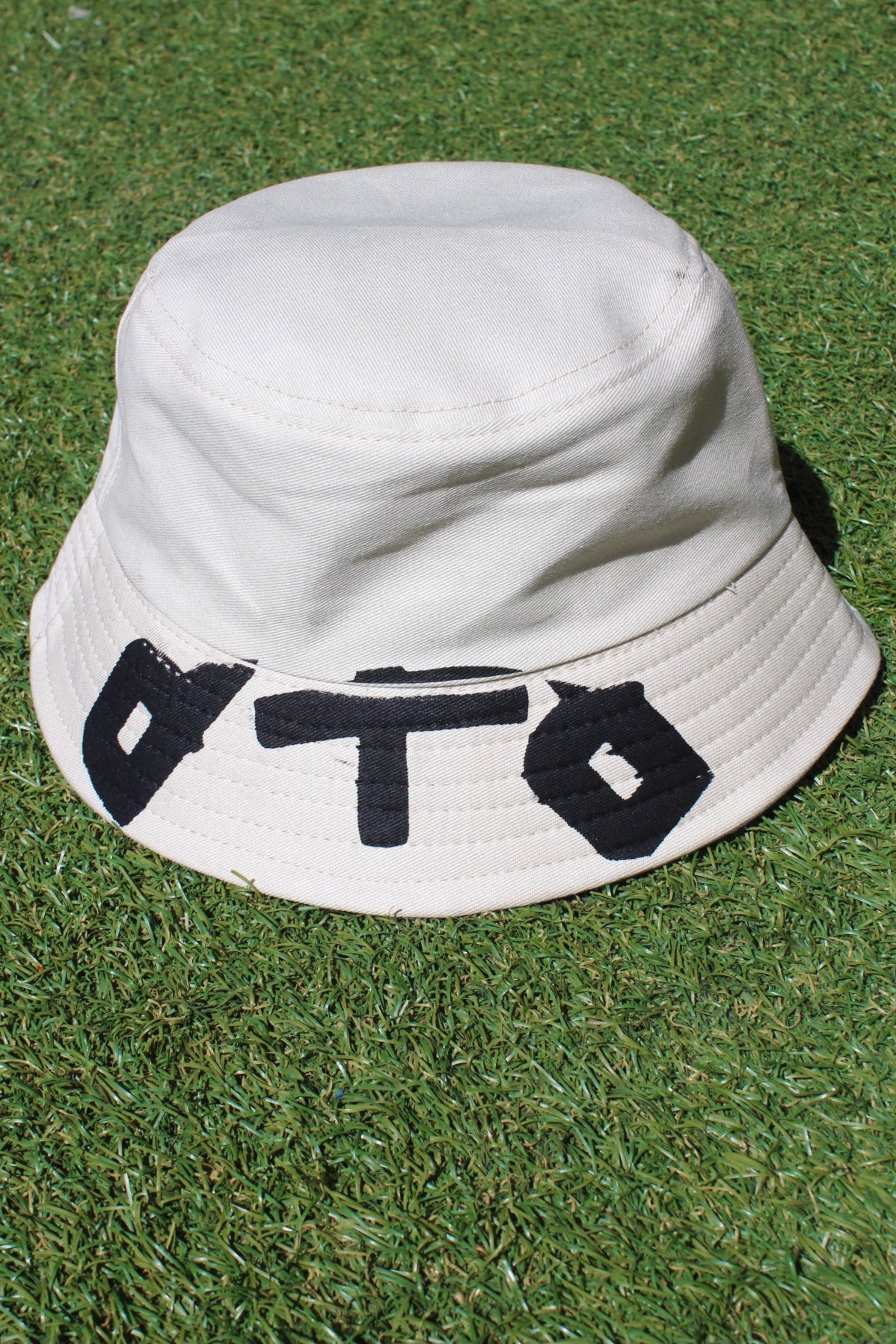 Image of up front bucket hat in tan