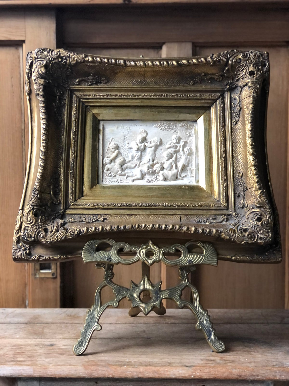 Image of Relief cherub plaque in ornate frame