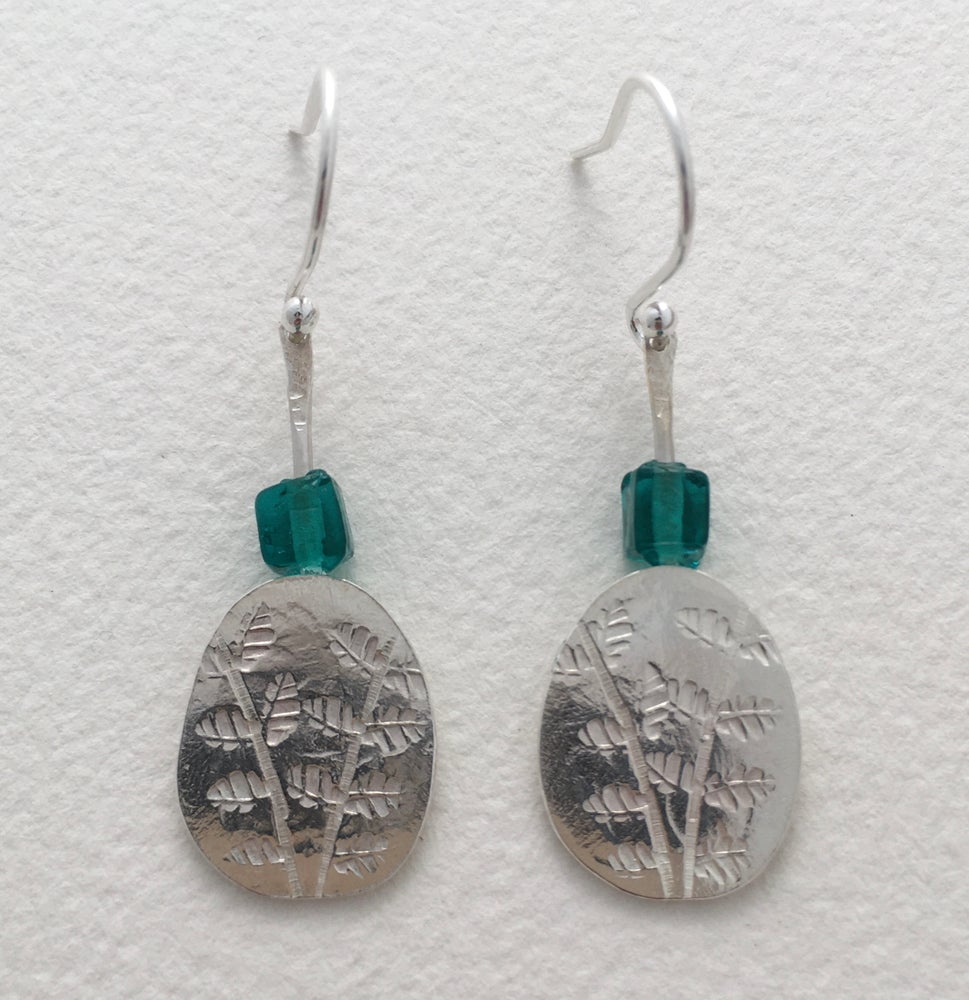 Image of Leaf earrings with glass bead.
