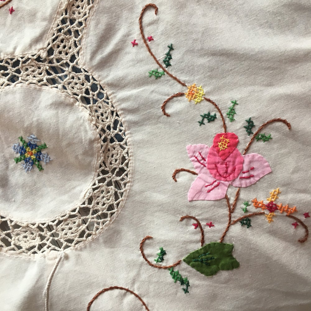 Image of Circular hand embroidered and crochet tablecloth