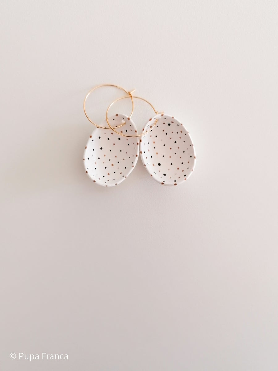 Image of Eggshell Earrings with Black and Golden dots