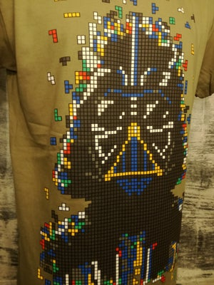 Image of  his all mighty from that famous block buster movie series , made of Tetris