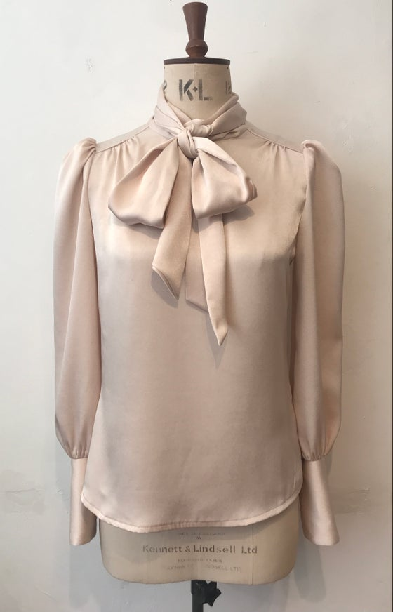 Image of Deep cuff satin tie neck blouse