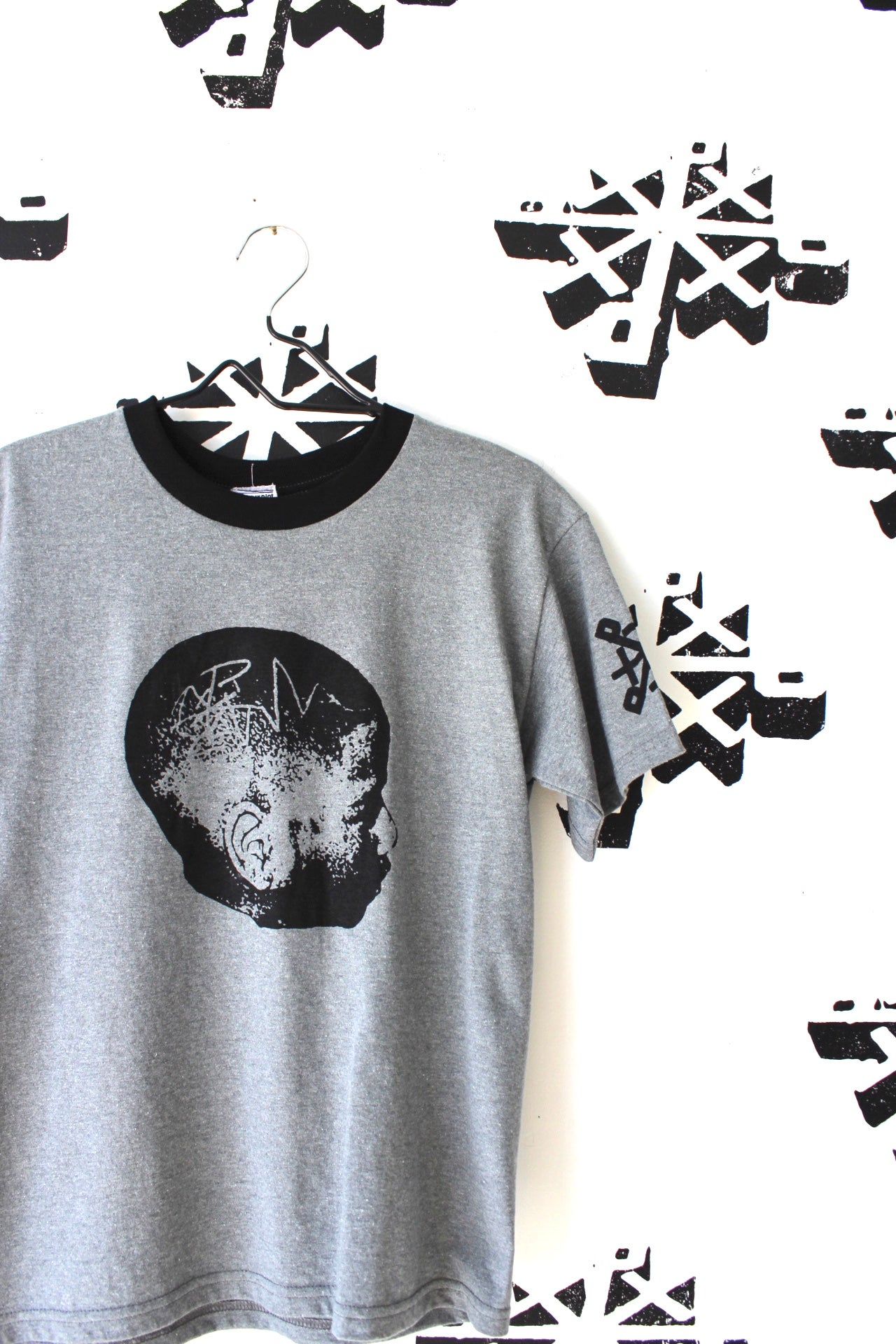 Image of head on straight ringer tee in gray/black