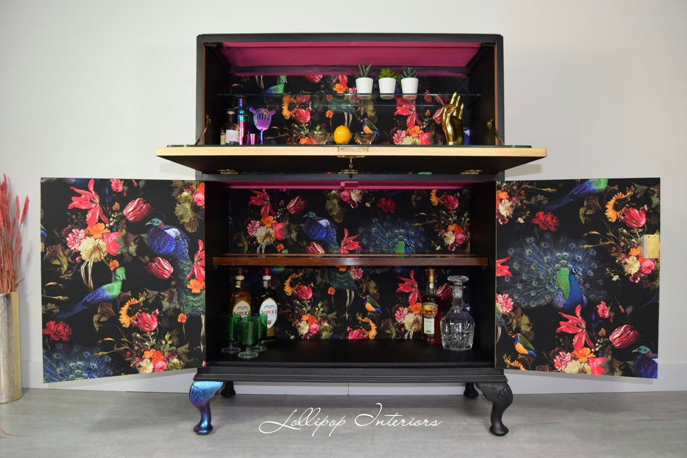 Image of Black cocktail cabinet with Erismann Peacock floral wallpaper