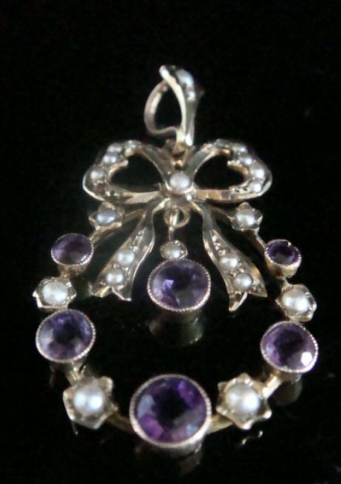 Image of Antique Edwardian 9ct yellow gold amethyst seed pearl bow pendant