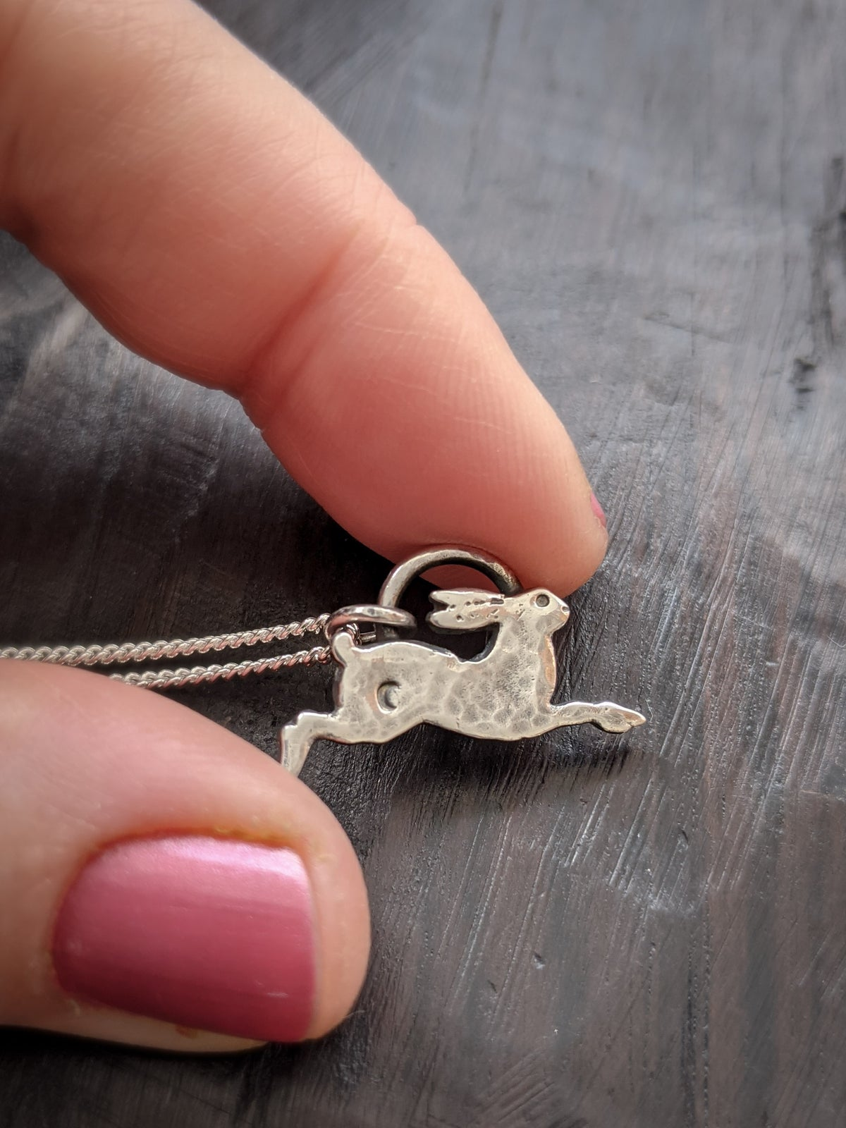 Tiny Leaping Hare hammered recycled silver pendant
