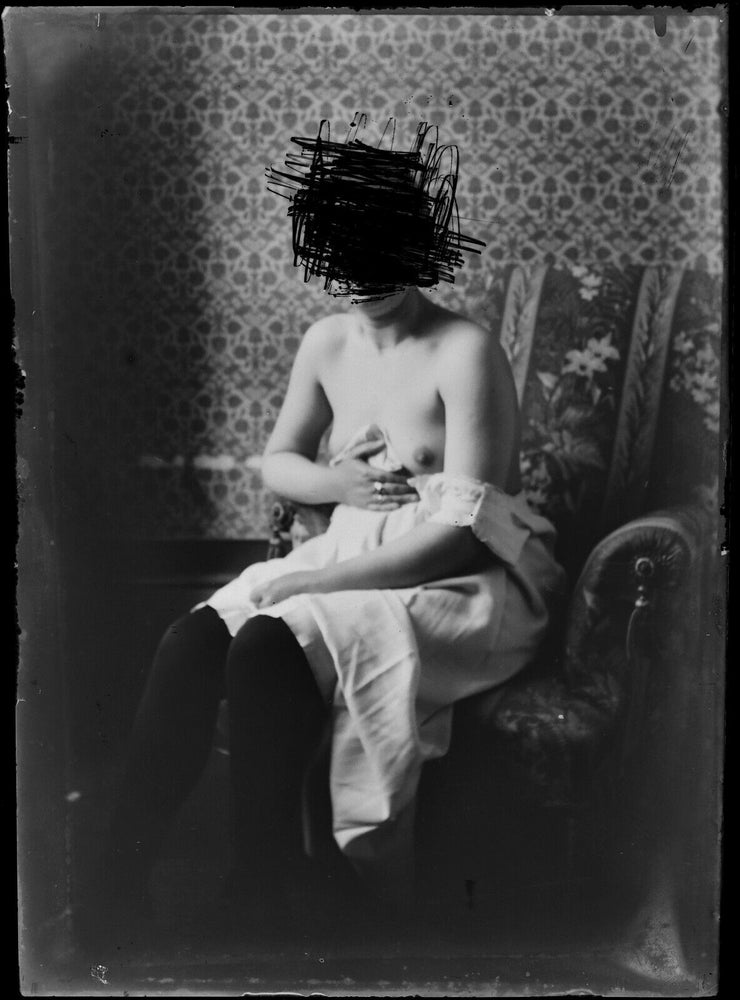 Image of Anonymous: glass negative of a defaced nude woman, ca. 1900