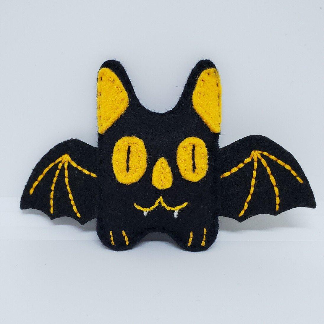 Teeny Black & Yellow Bat