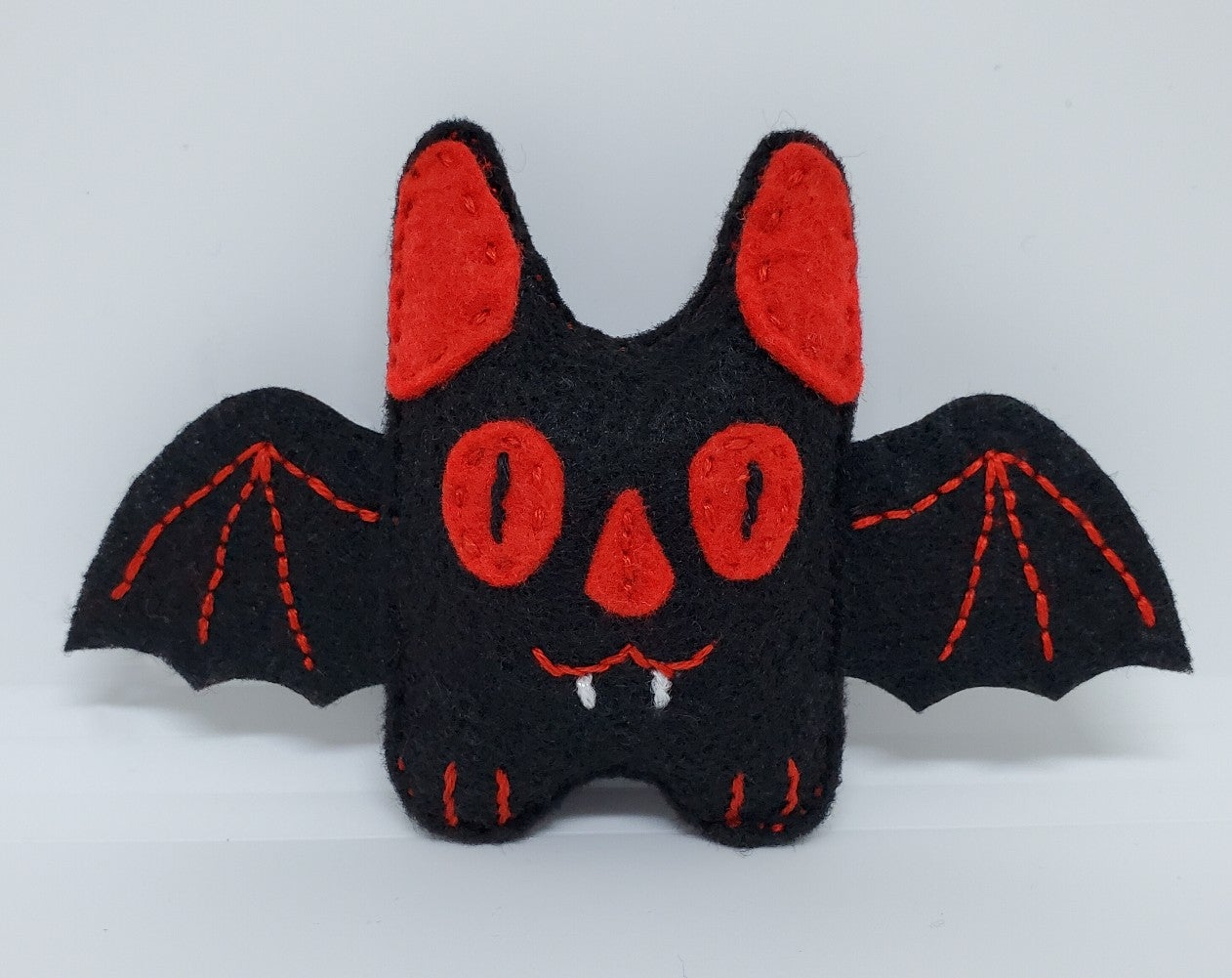 Teeny Black & Red Bat