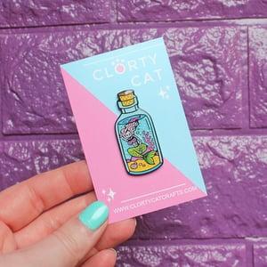 Image of Undead Mermaid in a Bottle enamel pin - skeleton - creepy cute - pastel goth - lapel pin badge