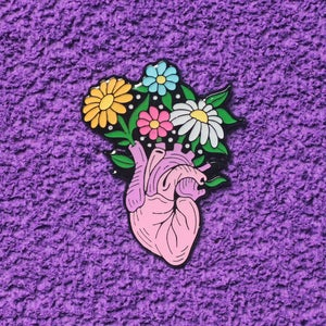 Image of Anatomical heart with flowers enamel pin - floral pin - creepy cute - pastel goth - lapel pin badge