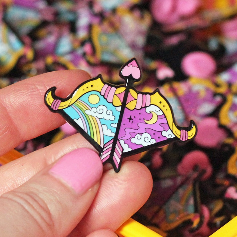 Image of Day & night Bow and Arrow enamel pin - bow pin - creepy cute - pastel goth - lapel pin badge