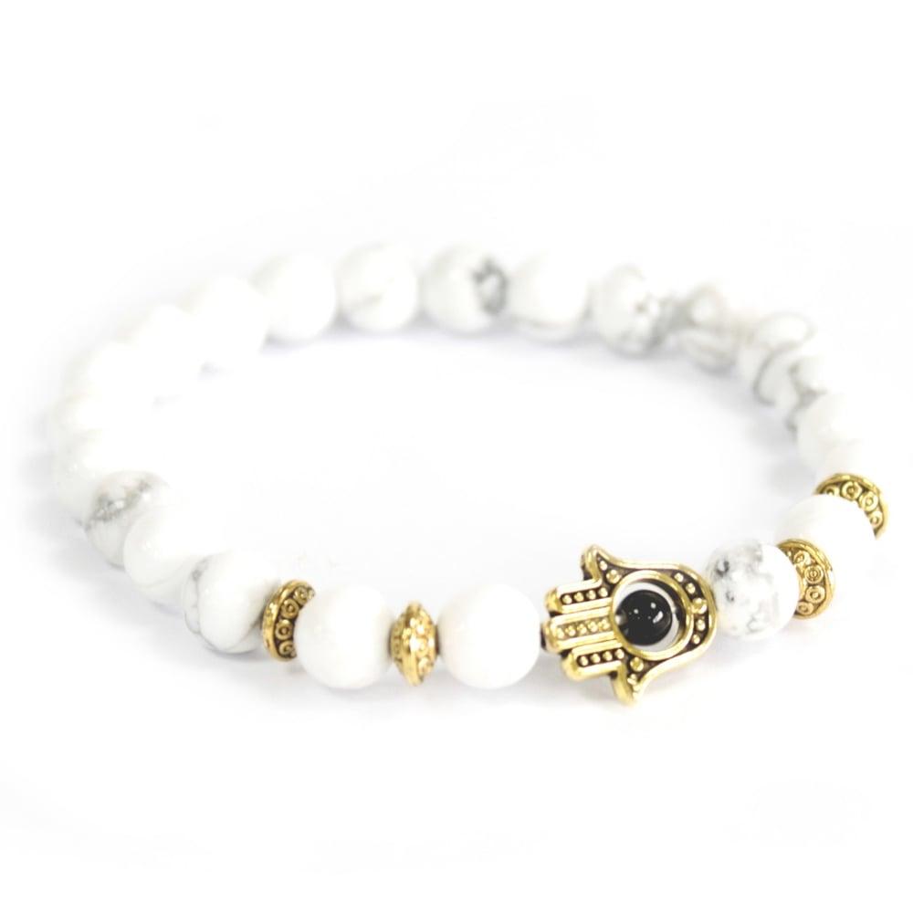 Image of Bracelet White Stone with Gold Hamsa
