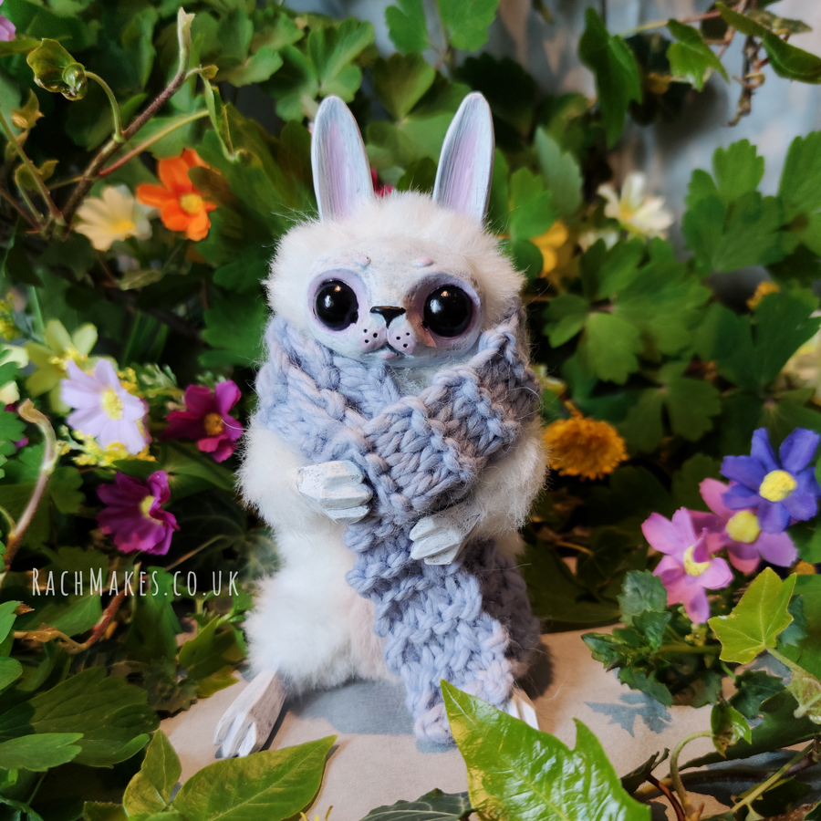Image of White Bunn with Ice Blue Scarf.