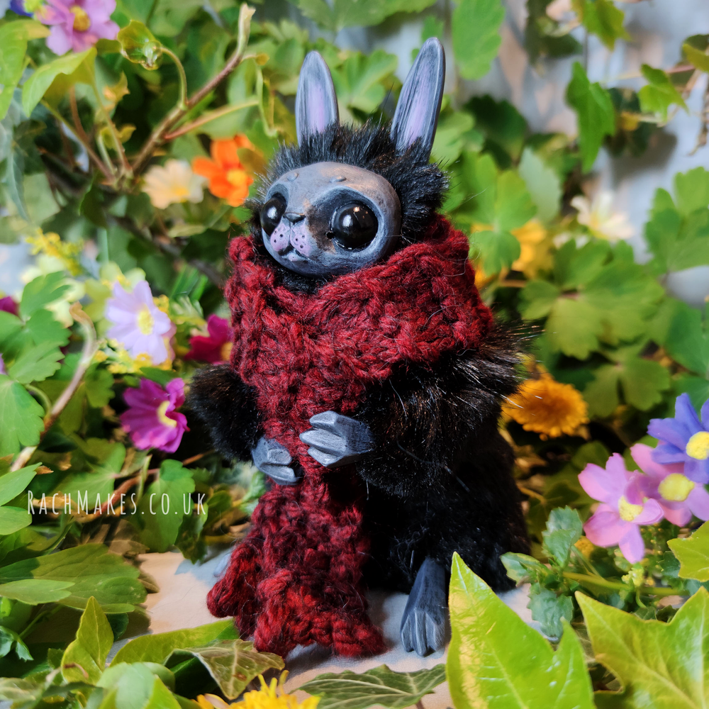 Image of Black Bunn with Red Scarf.