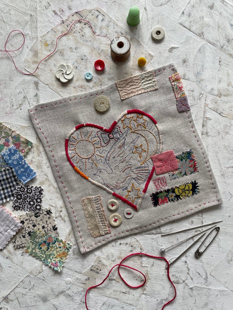 "Image of ""Dove & Heart"" embroidery template on soft grey"