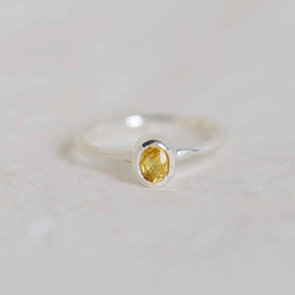 Image of Natural Yellow Sapphire oval cut silver ring