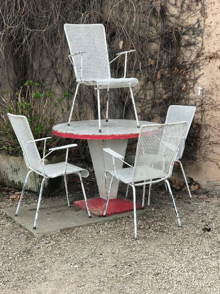 Image of Suite de 4 fauteuils en métal perforé Mathieu Matégot