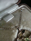 Edwardian 15ct natural peridot and pearl necklace on pearl chain in fitted leather tooled box