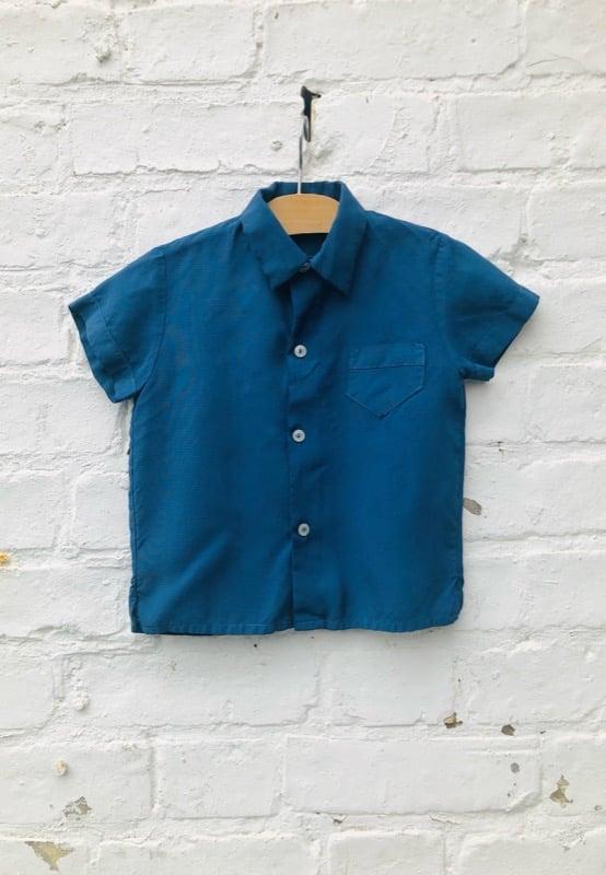 Image of Indigo blue over-dyed short sleeved shirt. Age 1-2yrs.