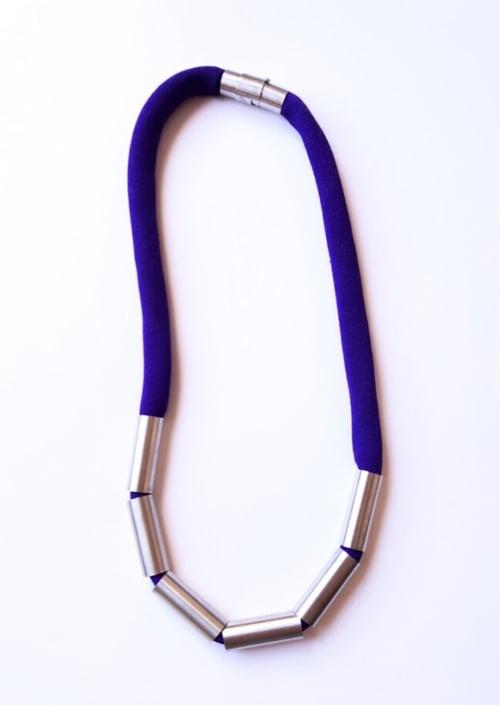 Image of Collaret Escates. Collar Escamas
