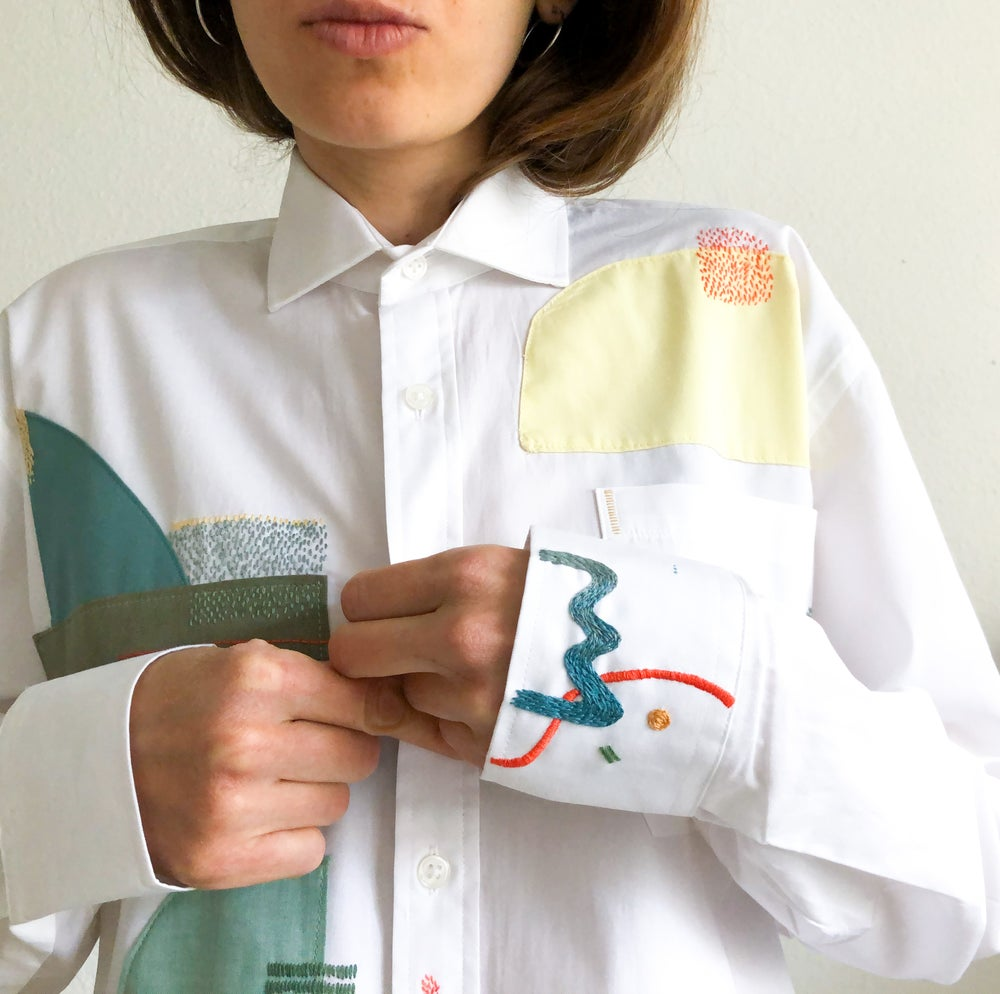 Image of Sunset over the sailboats marina - textile collage & hand embroidery on 100% cotton shirt
