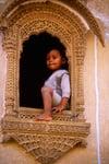 Boy in Ornate Window
