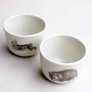 Image of set of two 8oz wee cups, with opossum and rabbit