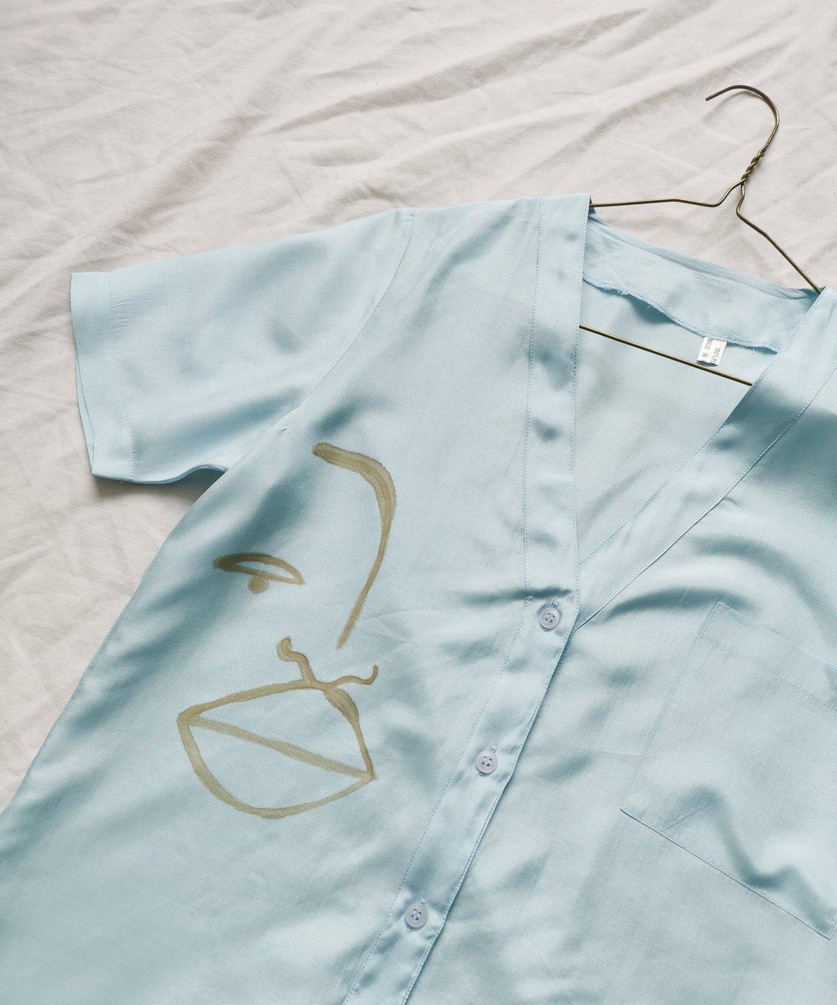 Image of blu blouse