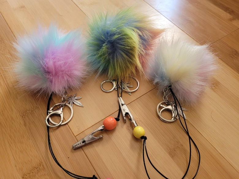 Image of Tie dyed look  pompoms with potleaf and roachclip