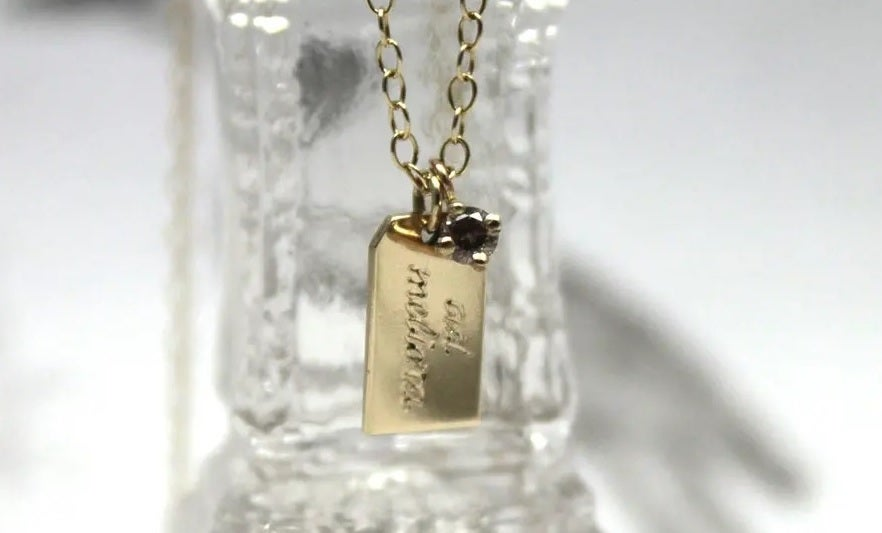 Image of Luggage Tag with Diamond Necklace