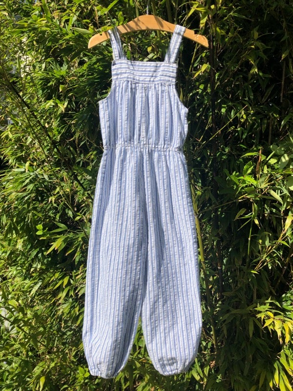 Image of Cotton seersucker dungarees in blue and white stripes. Age 5-6yrs.