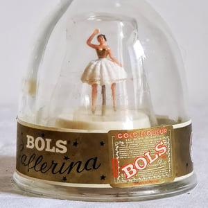 Ancienne bouteille danseuse boite à musique Bols 1950