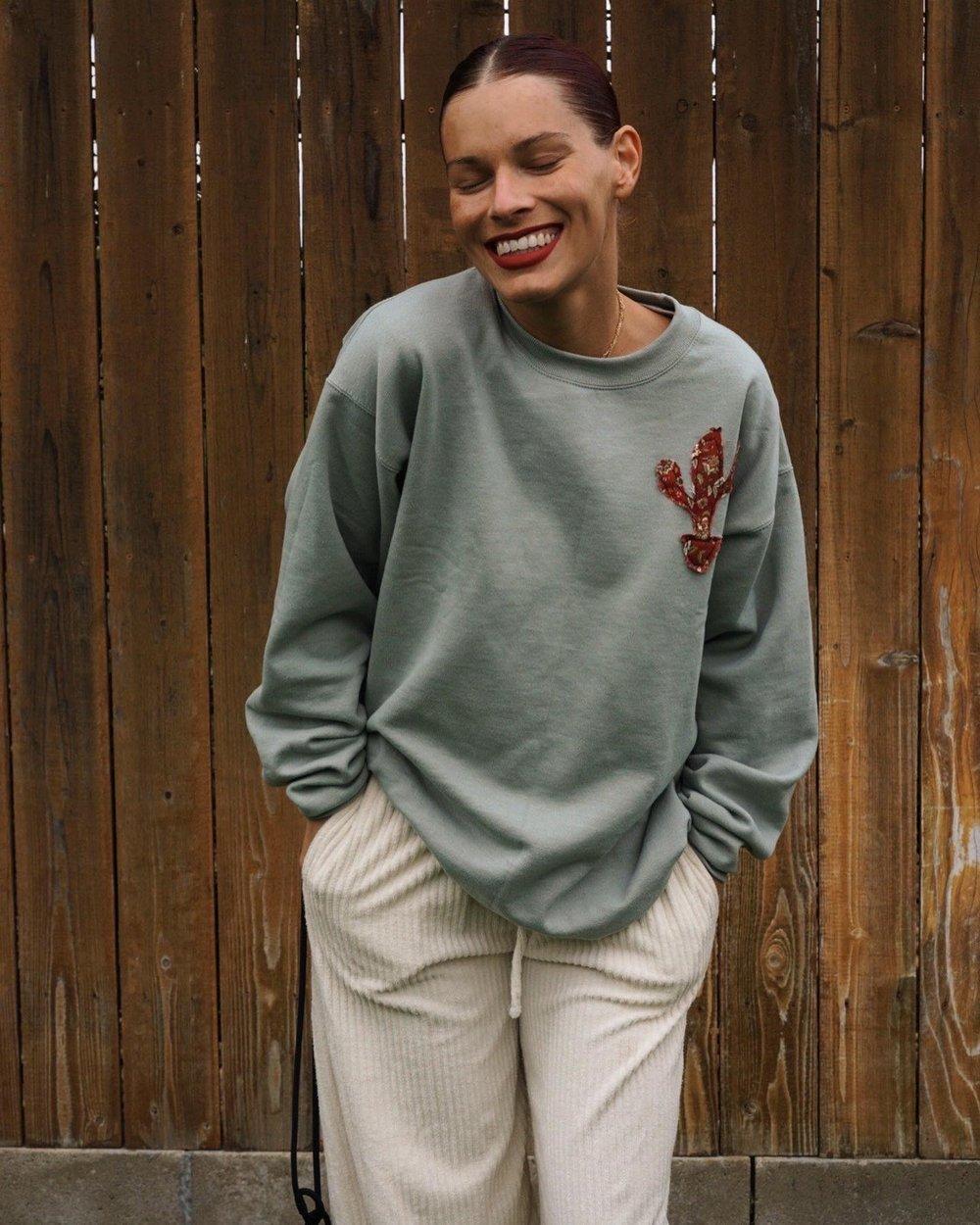 Image of olivine sweatshirt.