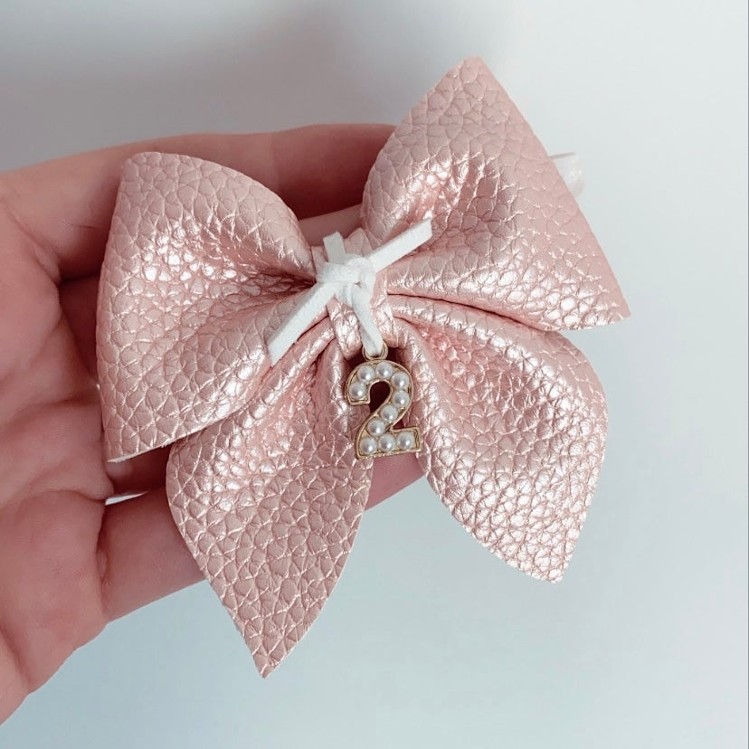 Image of PEARL CHARM BIRTHDAY BOW