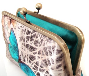 Image of Blue butterfly clutch bag