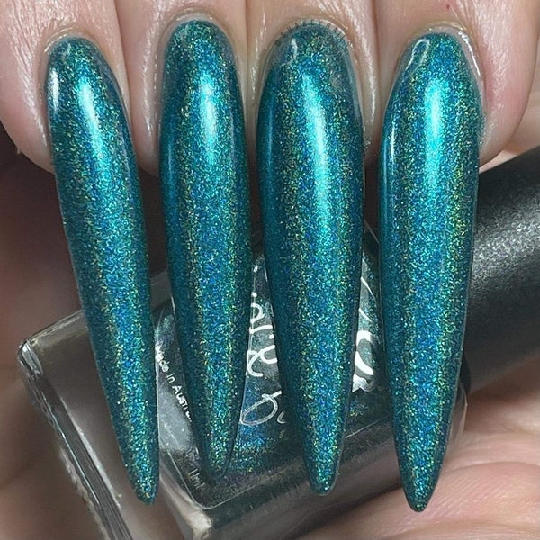 Image of Daintree – linear holo green teal with a metallic look and specks of blue flecks