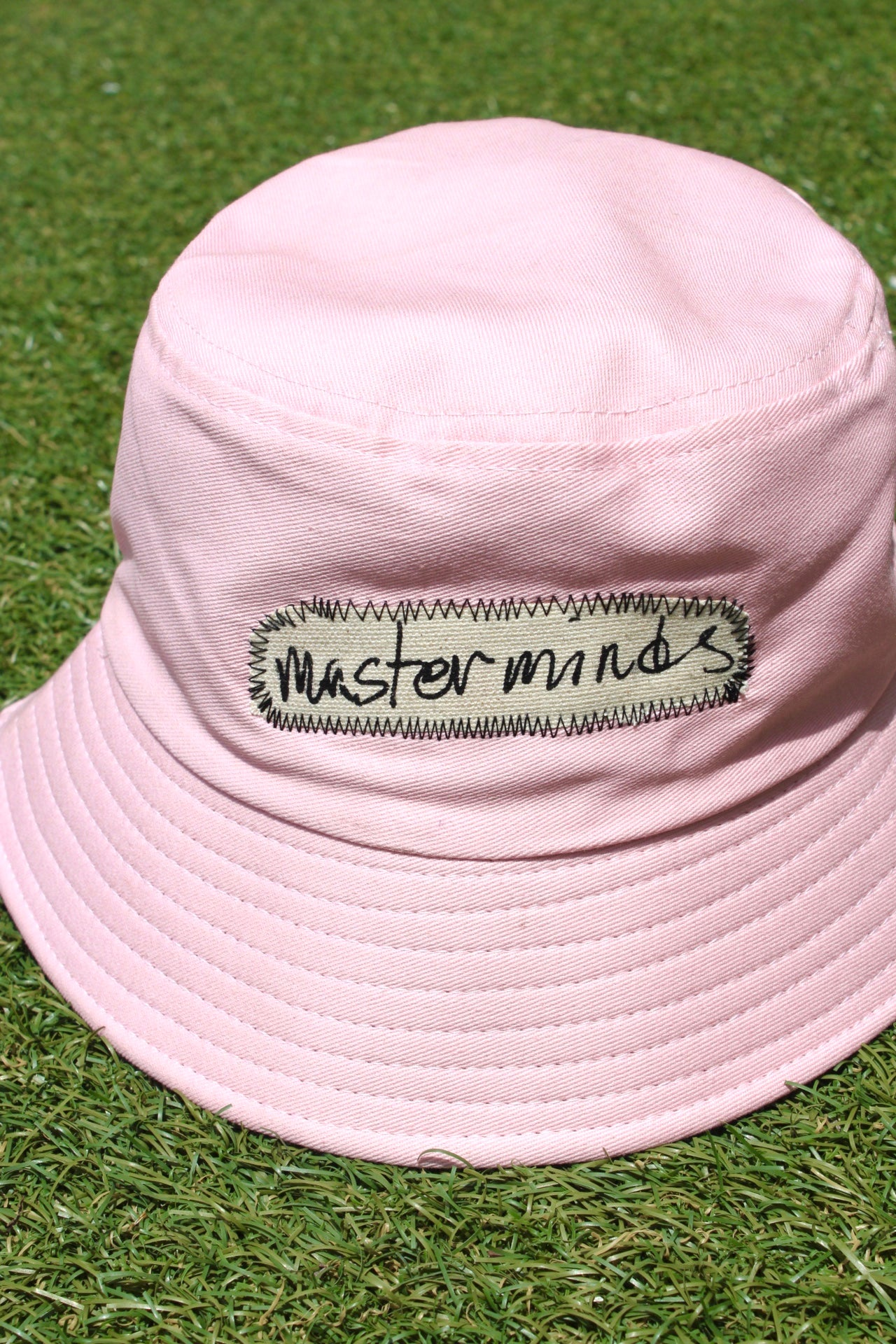 Image of masterminds bucket hat in pink
